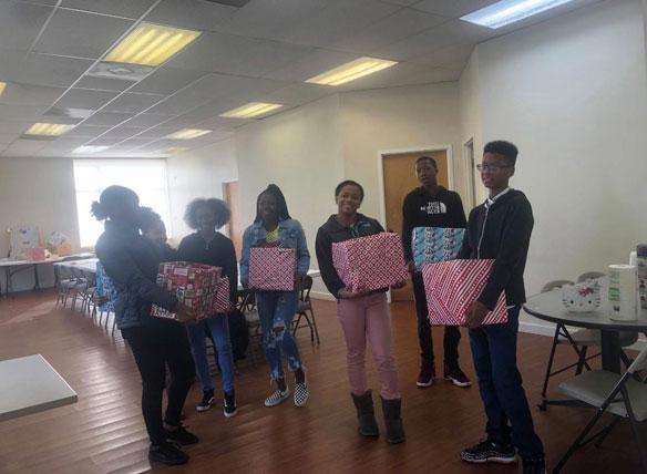 kids holding presents